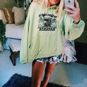 green travelers hoodie